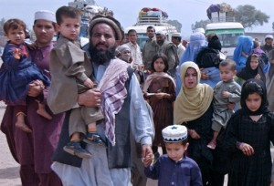 Afghan refugee families arrive at the United Nation High Commission for Refugees (UNHCR) repatriation center at Jalozai camp in Nowshera, some 30km from Peshawar, 30 March 2007. The UN refugee agency expressed concern at the recent displacement of Afghans refugees due to the ongoing conflict in the Afghan southern provinces of Helmand and Kandahar, where nearly 5,000 families have been driven from their homes, an official's media reports said. AFP PHOTO/Tariq MAHMOOD